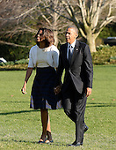 United States President Barack Obama and first lady Michelle Obama walk back to the Residence April 10, 2014 at the White House in Washington, DC. The President and First Lady attended a Civil Rights Summit to commemorate the 50th anniversary of the signing of the Civil Rights Act in Austin, Texas. <br /> Credit: Olivier Douliery / Pool via CNP