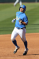 Mikey Perez (10) of the UCLA Bruins runs the bases during a game against the Cal State Fullerton Titans at Jackie Robinson Stadium on March 6, 2021 in Los Angeles, California. UCLA defeated Cal State Fullerton, 6-1. (Larry Goren/Four Seam Images)
