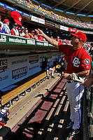 23 September 2007: Washington Nationals Manager Manny Acta tosses an autographed cap to a fan prior to the historic last professional baseball game played at Robert F. Kennedy Memorial Stadium in Washington, DC. The Nationals defeated the visiting Philadelphia Phillies 5-3 to close out the home season at RFK.. .Mandatory Photo Credit: Ed Wolfstein Photo