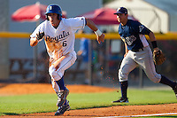 Gabe MacDougall #6 of the Burlington Royals takes off for home plate as the throw gets away from Scott Lawson #2 of the Princeton Rays at Burlington Athletic Stadium July 11, 2010, in Burlington, North Carolina.  Photo by Brian Westerholt / Four Seam Images