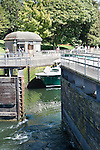 Tainter Gates open after boats have been lowered to the level of salt water. The Chittenden Locks and adjacent Carl English Gardens are major draws for tourists, locals, and the botting community.  Yachts enter and leave fresh water Lake Union for the salt of Puget Sound.