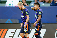 CARSON, CA - JUNE 19: Raúl Ruidíaz #9 of the Seattle Sounders FC scores a goal and celebrates with Kelyn Rowe #22 during a game between Seattle Sounders FC and Los Angeles Galaxy at Dignity Health Sports Park on June 19, 2021 in Carson, California.