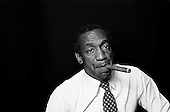 "Denver Colorado<br /> USA<br /> June 10, 1983<br /> <br /> Comedian Bill Cosby backstage after a performances at McNichols Sports Arena. <br /> <br /> William Henry ""Bill"" Cosby, Jr. (born July 12, 1937) is an American comedian, actor, author, television producer, educator, musician and activist. A veteran stand-up performer, he got his start at various clubs, then landed a starring role in the 1960s action show, I Spy. He later starred in his own series, the situation comedy The Bill Cosby Show, in 1969. He was one of the major characters on the children's television series The Electric Company for its first two seasons, and created the educational cartoon comedy series Fat Albert and the Cosby Kids, about a group of young friends growing up in the city. Cosby has also acted in a number of films.<br /> <br /> During the 1980s, Cosby produced and starred in what is considered to be one of the decade's defining sitcoms, The Cosby Show, which aired eight seasons from 1984 to 1992. The sitcom highlighted the experiences and growth of an upper-middle-class African-American family. He also produced the spin-off sitcom A Different World, which became second to The Cosby Show in ratings. He starred in the sitcom Cosby from 1996 to 2000 and hosted Kids Say the Darndest Things for two seasons.<br /> <br /> He has been a sought-after spokesman, and has endorsed a number of products, including Jell-O, Kodak film, Ford, Texas Instruments, and Coca-Cola, including New Coke. In 2002, scholar Molefi Kete Asante included him in his book, the 100 Greatest African Americans."