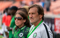 HOUSTON, TX - JUNE 10: Randy Waldrum of Nigeria watches his team before a game between Nigeria and Jamaica at BBVA Stadium on June 10, 2021 in Houston, Texas.