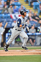 Columbia Fireflies third baseman Rigoberto Terrazas (9) runs to first base during a game against the Asheville Tourists at McCormick Field on April 12, 2018 in Asheville, North Carolina. The Fireflies defeated the Tourists 7-5. (Tony Farlow/Four Seam Images)