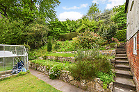 BNPS.co.uk (01202 558833)<br /> Pic: Homesestateagency/BNPS<br /> <br /> Pictured: The garden with a greenhouse.<br /> <br /> A timewarp home that has been lived in by the same family for more than a century has gone on sale for the first time since being built.<br /> <br /> At the time the property was built, King Edward VII was on the throne and the First World War had not even started.<br /> <br /> The property is being sold for £550,000 under probate by the original builder's three grandchildren, who were born in the Victorian-style house.<br /> <br /> The two-bedroomed home is in the Surrey town of Haslemere and belonged to the Berry family, who decided to sell after the death of their parents, Freda and Leslie.