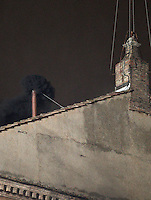Fumo nero esce dal comignolo sul tetto della Cappella Sistina, Citta' del Vaticano, 12 marzo 2013. La fumata nera indica che il nuovo Papa della Chiesa Cattolica Romana non e' stato ancora eletto dai 115 cardinali del Conclave..Black smoke billows from the chimney atop the Sistine Chapel where 115 cardinals gathered to elect the new Pope of the Roman Catholic Church, at the Vatican, 12 March 2013. The black smoke indicates that the cardinals in the Conclave have not elected the new Pontiff..UPDATE IMAGES PRESS/Riccardo De Luca STRICTLY FOR EDITORIAL USE ONLY - STRICTLY FOR EDITORIAL USE ONLY