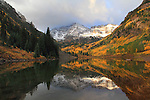 Autumn sunrise at Maroon Lake with autumn aspen trees, South and North Maroon Peaks behind, west of Aspen, Colorado, USA .  John leads private photo tours throughout Colorado. Year-round Colorado photo tours.