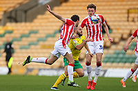 13th February 2021; Carrow Road, Norwich, Norfolk, England, English Football League Championship Football, Norwich versus Stoke City; Teemu Pukki of Norwich City attempts to sprint past James Chester and Harry Souttar of Stoke City