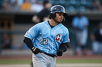 Isaias Quiroz (22) of the Hickory Crawdads hustles down the first base line against the Winston-Salem Dash at Truist Stadium on July 10, 2021 in Winston-Salem, North Carolina. (Brian Westerholt/Four Seam Images)