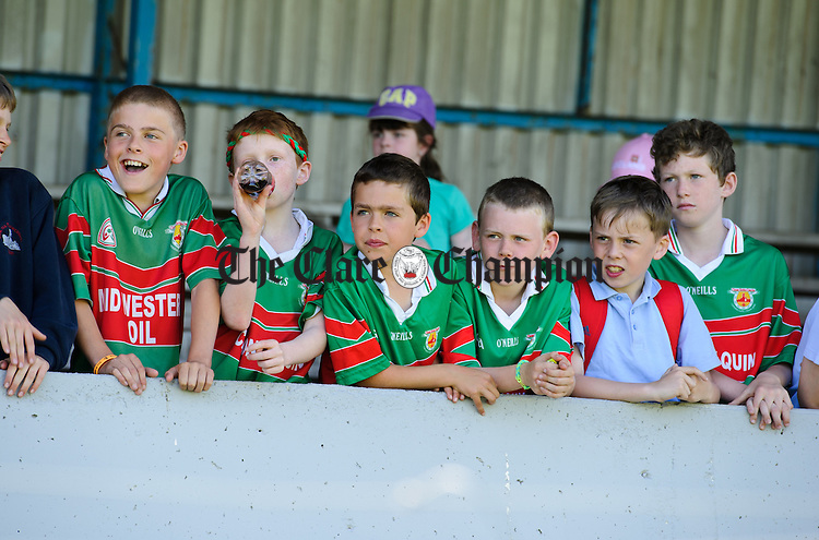 The lads from Quin cheer on their girls during the Div2B Primary Schools camogie final in Cusack park. Photograph by John Kelly.