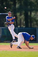 Shortstop Jake Lemmerman #12 of the Duke Blue Devils makes a throw to first base as third baseman Dennis O'Grady #26 ducks out of the way at Jack Coombs Field March 29, 2009 in Durham, North Carolina. (Photo by Brian Westerholt / Four Seam Images)