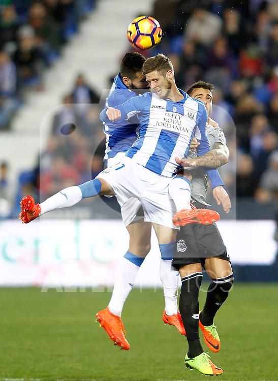 CD Leganes' Dimitrios Siovas (l) and Ruben Perez (c) and Deportivo de la Coruna's Carles Gil during La Liga match. February 25,2017. (ALTERPHOTOS/Acero)