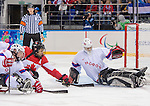Sochi, RUSSIA - Mar 15 2014 - Brad Bowden has his shot stopped by Kristian Buen as Canada takes on Norway in the Bronze Medal Sledge Hockey game  at the 2014 Paralympic Winter Games in Sochi, Russia.  (Photo: Matthew Murnaghan/Canadian Paralympic Committee)