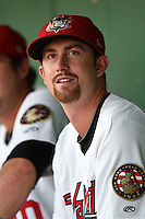 Tri-City ValleyCats pitcher Chris Munnelly (23) in the dugout during a game against the Batavia Muckdogs on August 2, 2014 at Joseph L. Bruno Stadium in Troy, New  York.  Tri-City defeated Batavia 8-4.  (Mike Janes/Four Seam Images)