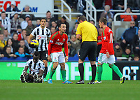 Saturday 17 November 2012<br /> Pictured: Leon Britton of Swansea referee Phil Dowd, Cheick Tiote Pablo Hernandez<br /> Re: Barclay's Premier League, Newcastle United v Swansea City FC at St James' Park, Newcastle Upon Tyne, UK.