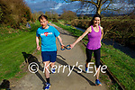 Blind runner Ross Gallagher with his running guide Ailis Brosnan running in Castleisland on Friday.