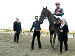 Toby's Corner, jockey Eddie Castro up, is lead to the winner's circle by owner Dianne Cotter after winning the Wood Memorial at Aqueduct Race Track in Ozone Park, New York on April 9, 2011.  Favorite Uncle Mo was third.