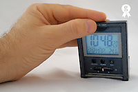 Man checking time on digital alarm clock, close-up of hand (Licence this image exclusively with Getty: http://www.gettyimages.com/detail/73532574 )