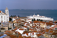 Portugal, Lisbon. View from Largo das Portas do Sol overlooking the Alfama district. Docked cruise ship of the Princess line in river Tejo. Lisbon, Portugal.