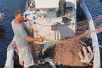 - island of Pantelleria,  fisherman in the port of Scauri village....- isola di Pantelleria, pescatore nel porto del villaggio di Scauri