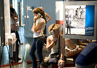 Tourists in the documentation centre of the Berlin Wall Memorial.