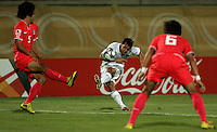 The United States' Danny Cruz (5) makes a pass between South Korea's Young Gwon Kim (5), left, and Jeong Ho Hong (6), right, during the FIFA Under 20 World Cup Group C match between the United States and South Korea at the Mubarak Stadium on October 02, 2009 in Suez, Egypt. The US team lost 3-0.