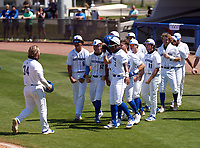 IMG Academy Ascenders Tommy White (34) celebrates hitting a home run with teammates - including Davion Hickson (6), Blaydon Plain (12), and Elijah Green (2) - during a game against the Calvary Christian Academy Eagles on March 13, 2021 at IMG Academy in Bradenton, Florida.  (Mike Janes/Four Seam Images)