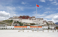 A Chinese flag flies in Potala Square, Lhasa. .