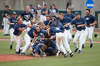 The Wingate Bulldogs pile on one another as the celebrate their win over the Central Missouri Mules during the 2021 DII Baseball National Championship at Coleman Field at the USA Baseball National Training Complex on June 12, 2021 in Cary, North Carolina. The Bulldogs defeated the Mules 5-3. (Brian Westerholt/Four Seam Images)