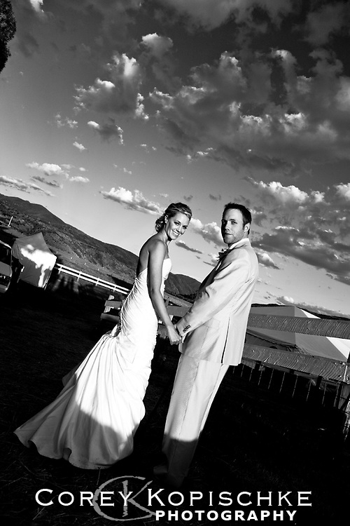 Bride and groom look back one more time before entering reception party in Steamboat Springs Colorado.