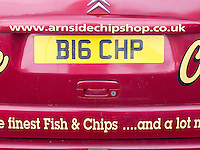 """The """"Big Chip"""", Arnside Chip Shop's van with personalised number plate advertising the shop, Arnside, Lancashire, UK"""