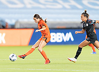 HOUSTON, TX - SEPTEMBER 10: Shea Groom #6 of the Houston Dash passes the ball before Mallory Pugh #9 of the Chicago Red Stars can close in on her during a game between Chicago Red Stars and Houston Dash at BBVA Stadium on September 10, 2021 in Houston, Texas.