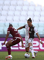 Calcio, Serie A: Juventus - Torino, Turin, Allianz Stadium, July 4, 2020.<br /> Juventus' Cristiano Ronaldo (r) in action with Torino's Gleison Bremer (l) during the Italian Serie A football match between Juventus and Torino at the Allianz stadium in Turin, July 4, 2020.<br /> UPDATE IMAGES PRESS/Isabella Bonotto