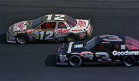 Mike Alexander (12) and Dale Earnhardt  in action in the Atlanta Journal 500 at Atlanta International Raceway in Hampton, GA, November 1988.  (Photo by Brian Cleary/www.bcpix.com)