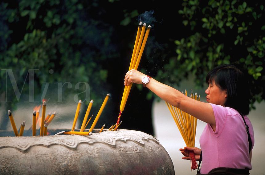 Incense offering to Buddha at the Po Lin Monastery, Lantan, China