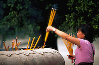 Incense offering to Buddha at the Po Lin Monastery, Lantan, China