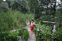"Children play in the ""Living Water Garden"" in Chengdu, Sichuan Province. The garden is a park aimed at highlighting the importance of the relationship between man and water. 2010"