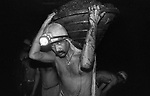 Lakhan tanti a loader carrying a busket of coal to fill a rake at North Searsole Coliery in Ranigunj, West Bengal, India. Arindam Mukherjee