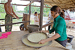 Woman Sifting Crushed Rice