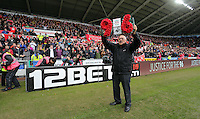 Liverpool supporter Barry Devonside, whose son Christopher died in the Hillsborough disaster, holding a wreath in tribute to those who died, before the Barclays Premier League match between Swansea City and Liverpool at the Liberty Stadium, Swansea on Sunday May 1st 2016