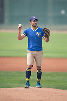 A Milwaukee Brewers fan prepares to deliver the first pitch before a Pioneer League game between the Helena Brewers and the Grand Junction Rockies at Kindrick Legion Field on August 19, 2018 in Helena, Montana. The Grand Junction Rockies defeated the Helena Brewers by a score of 6-1. (Zachary Lucy/Four Seam Images)