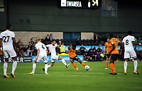 Pictured: Jean Louis Akpa Akpro of Barnet takes a shot while marked by Matty Grimes of Swansea City Wednesday 12 July 2017<br /> Re: Pre-season friendly, Barnet v Swansea City FC at The Hive, London, UK