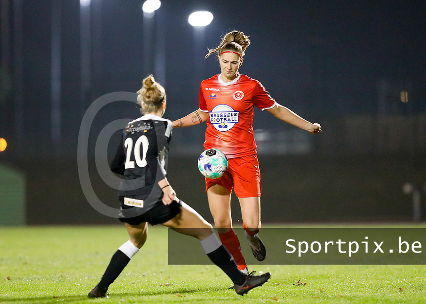 Marie Bougard (10) of Woluwe pictured in front of former teammate Sheila Broos (20) of Eendracht Aalst during a female soccer game between FC Femina White Star Woluwe and Eendracht Aalst on the sixth matchday in the 2021 - 2022 season of Belgian Scooore Womens Super League , friday 8 th of october 2021  in Woluwe , Belgium . PHOTO SPORTPIX   KRISTOF DE MOOR