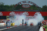 Aug. 31, 2012; Claremont, IN, USA: NHRA pro stock driver Jeg Coughlin (left) burns out alongside Jason Line during qualifying for the US Nationals at Lucas Oil Raceway. Mandatory Credit: Mark J. Rebilas-