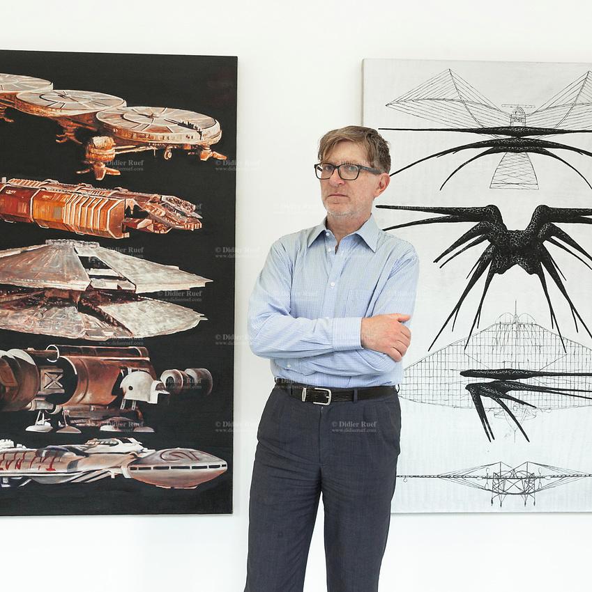 "Switzerland. Canton Ticino. Locarno. Riccardo Lisi is the director of the art gallery "" la rada"" (Spazio per l'arte contemporanea). ""Battlestar Galactica Spaceships"" (2019) (L) and ""Shadow Ship"" (2019) (R) are paintings by swiss artist Mathis Gasser. 1.05.2020 © 2020 Didier Ruef"