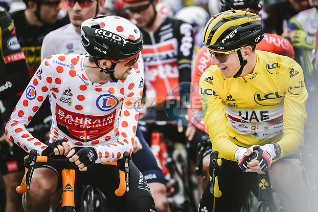 Polka Dot Jersey Wout Poels (NED) Bahrain Victorious and Yellow Jersey Tadej Pogacar (SLO) UAE Team Emirates line up for the start of Stage 9 of the 2021 Tour de France, running 150.8km from Cluses to Tignes, France. 4th July 2021.  <br /> Picture: A.S.O./Pauline Ballet | Cyclefile<br /> <br /> All photos usage must carry mandatory copyright credit (© Cyclefile | A.S.O./Pauline Ballet)