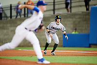 Siena Saints center fielder Brendan Conley (1) leads off first base as pitcher Brady Singer delivers a pitch during a game against the Florida Gators on February 16, 2018 at Alfred A. McKethan Stadium in Gainesville, Florida.  Florida defeated Siena 7-1.  (Mike Janes/Four Seam Images)