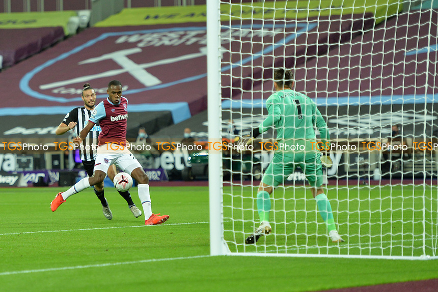 Issa Diop of West Ham United clears from Andy Carroll of Newcastle United during West Ham United vs Newcastle United, Premier League Football at The London Stadium on 12th September 2020