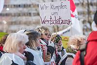 """Warnstreik bei der Arbeiterwohlfahrt """"AWO"""" Berlin am Montag den 19. Maerz 2018.<br /> Die Dienstleistungsgewerkschaft ver.di hat die rund 1.800 Beschaeftigten der Berliner AWO zu einem zweitaegigen Warnstreik aufgerufen. Am ersten Tag des Warnstreiks versammelten sich die AWO-Mitarbeiterinnen und Mitarbeiter vor der Senatsverwaltung fuer Senatsverwaltung Bildung, Jugend und Familie um ihrer Forderrung nach Anhebung der derzeitigen Entgelttabellen auf 95 Prozent des Niveaus des Tarifvertrages der Laender (TV-L) Nachdruck zu verleihen. Momentan erhalten die Mitarbeiterinnen und Mitarbeiter der Arbeiterwohlfahrt bis zu 475,- Euro weniger.<br /> 19.3.2018, Berlin<br /> Copyright: Christian-Ditsch.de<br /> [Inhaltsveraendernde Manipulation des Fotos nur nach ausdruecklicher Genehmigung des Fotografen. Vereinbarungen ueber Abtretung von Persoenlichkeitsrechten/Model Release der abgebildeten Person/Personen liegen nicht vor. NO MODEL RELEASE! Nur fuer Redaktionelle Zwecke. Don't publish without copyright Christian-Ditsch.de, Veroeffentlichung nur mit Fotografennennung, sowie gegen Honorar, MwSt. und Beleg. Konto: I N G - D i B a, IBAN DE58500105175400192269, BIC INGDDEFFXXX, Kontakt: post@christian-ditsch.de<br /> Bei der Bearbeitung der Dateiinformationen darf die Urheberkennzeichnung in den EXIF- und  IPTC-Daten nicht entfernt werden, diese sind in digitalen Medien nach §95c UrhG rechtlich geschuetzt. Der Urhebervermerk wird gemaess §13 UrhG verlangt.]"""